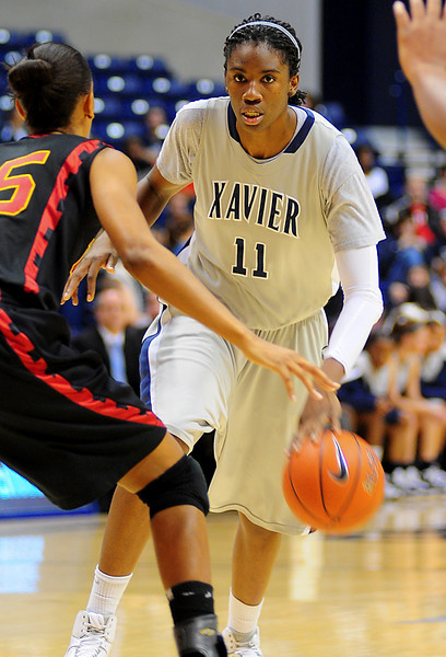 Xavier forward Amber Harris (11) driving past USC Trojans guard Briana Gilbreath (15.  (#4) Xavier defeated USC Trojans 69 - 66 at the Cintas Center in Cincinnati, Ohio.