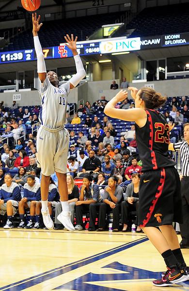 Xavier forward Amber Harris (11) steals the inbound  pass from USC Trojans guard Jacki Gemelos (23).  (#4) Xavier defeated USC Trojans 69 - 66 at the Cintas Center in Cincinnati, Ohio.