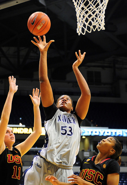 Xavier center Ta'Shia Phillips (53) goes up strong over USC Trojans forward Cassie Harberts (11) for a lay up.   (#4) Xavier defeated USC Trojans 69 - 66 at the Cintas Center in Cincinnati, Ohio.