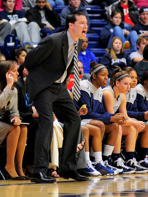 Xavier head coach Kevin McGuff yelling to his players.  (#4) Xavier defeated USC Trojans 69 - 66 at the Cintas Center in Cincinnati, Ohio.