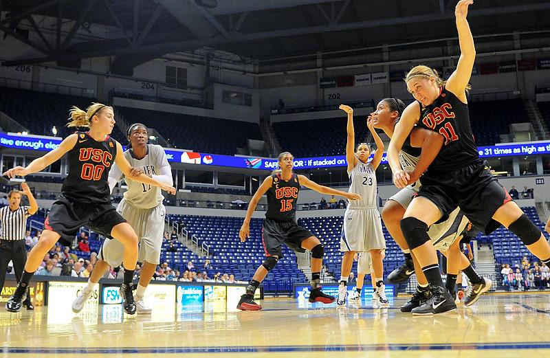 Xavier center Ta'Shia Phillips (53)blocking out USC Trojans forward Cassie Harberts (11) after Xavier guard Megan Askew (23) shoots her free throw.  (#4) Xavier defeated USC Trojans 69 - 66 at the Cintas Center in Cincinnati, Ohio.
