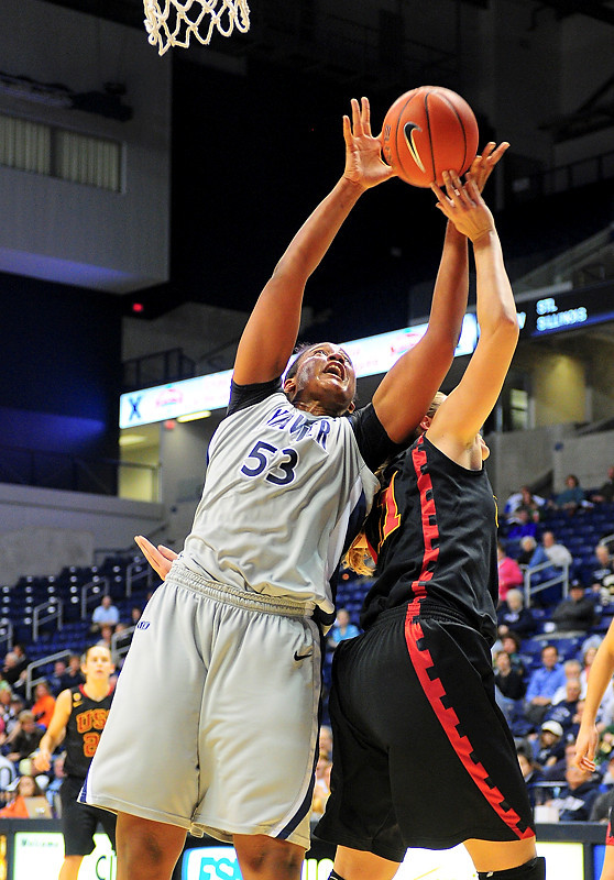 Xavier center Ta'Shia Phillips (53) grabs the rebound USC Trojans forward Cassie Harberts (11).   (#4) Xavier defeated USC Trojans 69 - 66 at the Cintas Center in Cincinnati, Ohio.