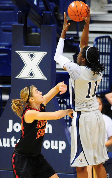 Xavier forward Amber Harris (11) shoots the ball over USC Trojans forward Christina Marinacci (00).   (#4) Xavier defeated USC Trojans 69 - 66 at the Cintas Center in Cincinnati, Ohio.