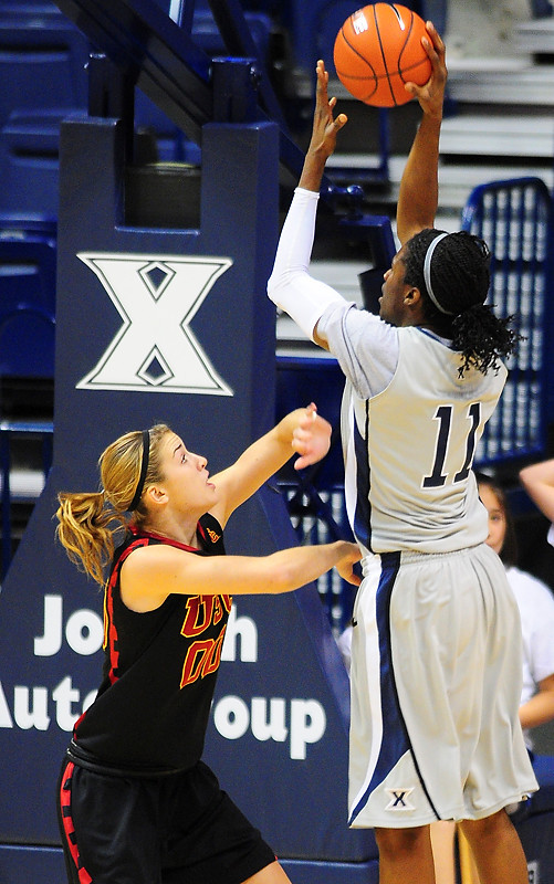 Xavier forward Amber Harris (11) shoots the ball over USC Trojans forward Christina Marinacci (00).   (#4) Xavier defeated USC Trojans 69 - 66 at the Cintas Center in Cincinnati, Ohio.