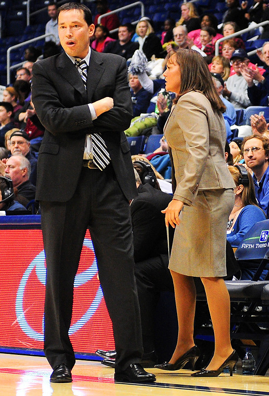 Xavier head coach Kevin McGuff with assistant coach Amy Waugh in the back ground.  (#4) Xavier defeated USC Trojans 69 - 66 at the Cintas Center in Cincinnati, Ohio.