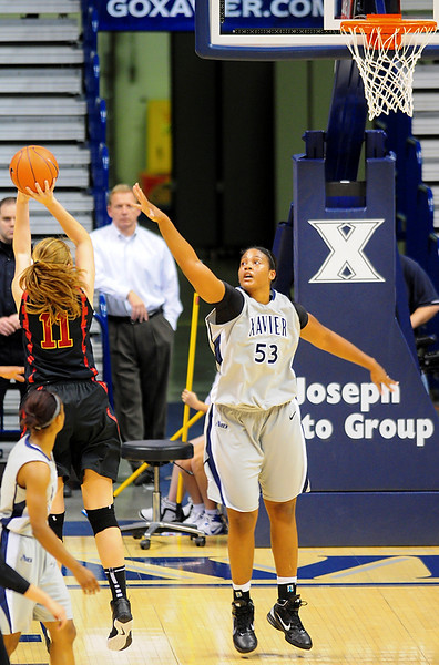 USC Trojans forward Cassie Harberts (11) shoots the ball over Xavier center Ta'Shia Phillips (53).  (#4) Xavier defeated USC Trojans 69 - 66 at the Cintas Center in Cincinnati, Ohio.