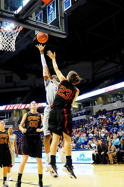 After stealing the inbound pass Xavier forward Amber Harris (11) makes a lay up over USC Trojans guard Jacki Gemelos (23).  (#4) Xavier defeated USC Trojans 69 - 66 at the Cintas Center in Cincinnati, Ohio.