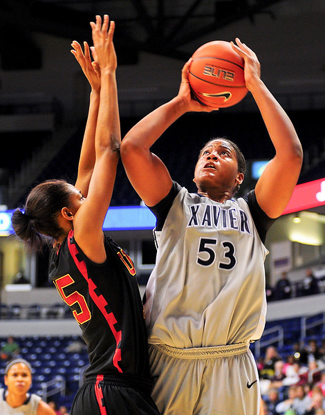 Xavier center Ta'Shia Phillips (53) shoots the ball over USC Trojans guard Briana Gilbreath (15).  (#4) Xavier defeated USC Trojans 69 - 66 at the Cintas Center in Cincinnati, Ohio.