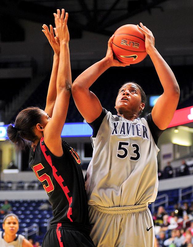 Xavier center Ta'Shia Phillips (53) shoots the ball over USC Trojans guard Briana Gilbreath (15).  (#4) Xavier defeated USC Trojans 69 - 66 at the Cintas Center in Cincinnati, Ohio.