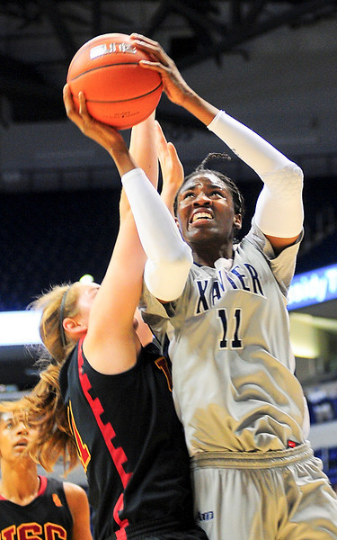 Xavier forward Amber Harris (11) is fouled while driving to the basket for two over USC Trojans forward Cassie Harberts (11).  (#4) Xavier defeated USC Trojans 69 - 66 at the Cintas Center in Cincinnati, Ohio.