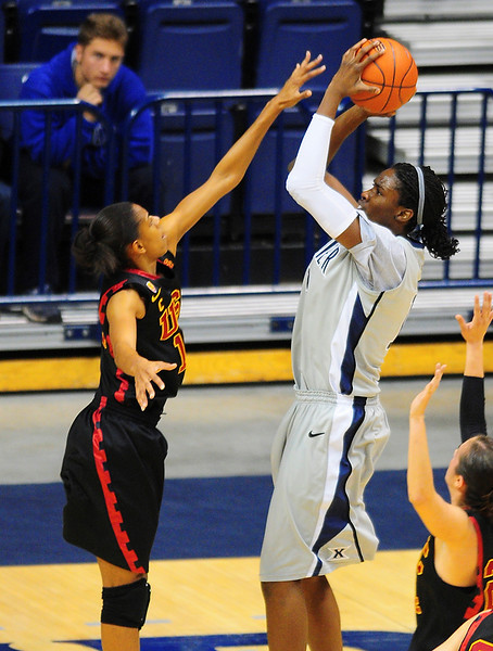 Xavier forward Amber Harris (11) shoots the ball over USC Trojans guard Briana Gilbreath (15).  (#4) Xavier defeated USC Trojans 69 - 66 at the Cintas Center in Cincinnati, Ohio.