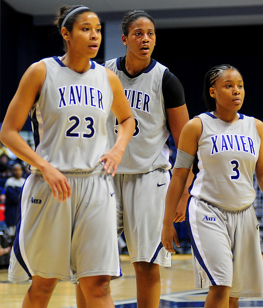 Xavier center Ta'Shia Phillips (53) between Xavier guard Megan Askew (23) and Xavier guard Shatyra Hawkes (3).  (#4) Xavier defeated USC Trojans 69 - 66 at the Cintas Center in Cincinnati, Ohio.
