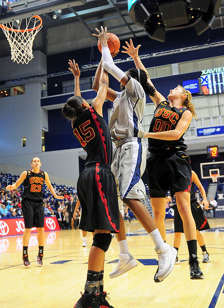 Xavier forward Amber Harris (11) shoots the ball over USC Trojans guard Briana Gilbreath (15) for 2 of her game high 28 points.  (#4) Xavier defeated USC Trojans 69 - 66 at the Cintas Center in Cincinnati, Ohio.