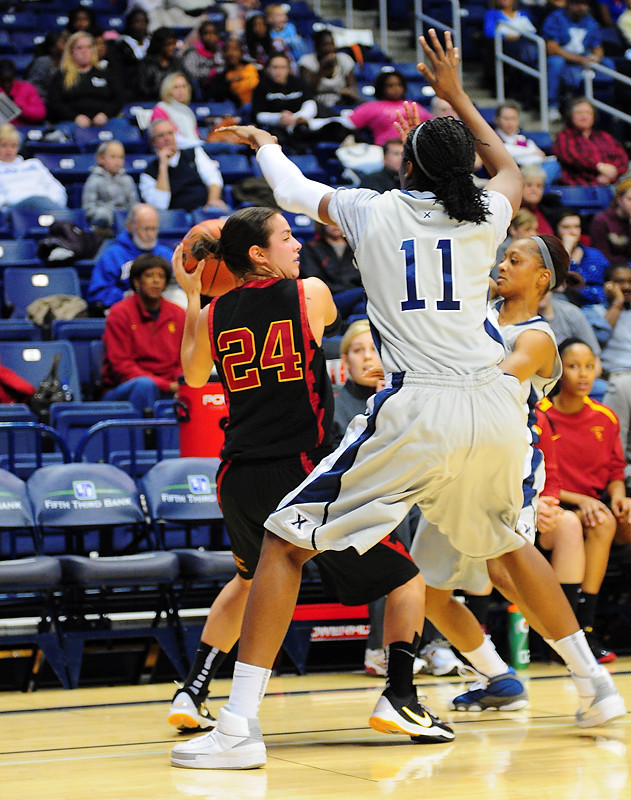 USC Trojans guard Ashley Corral (24) had to call time out since Xavier forward Amber Harris (11) and Xavier guard Special Jennings (1) had her trapped in the corner.   (#4) Xavier defeated USC Trojans 69 - 66 at the Cintas Center in Cincinnati, Ohio.