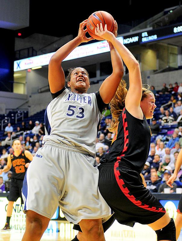 Xavier center Ta'Shia Phillips (53) grabs 1 of her 16 rebound over USC Trojans forward Cassie Harberts (11).  (#4) Xavier defeated USC Trojans 69 - 66 at the Cintas Center in Cincinnati, Ohio.