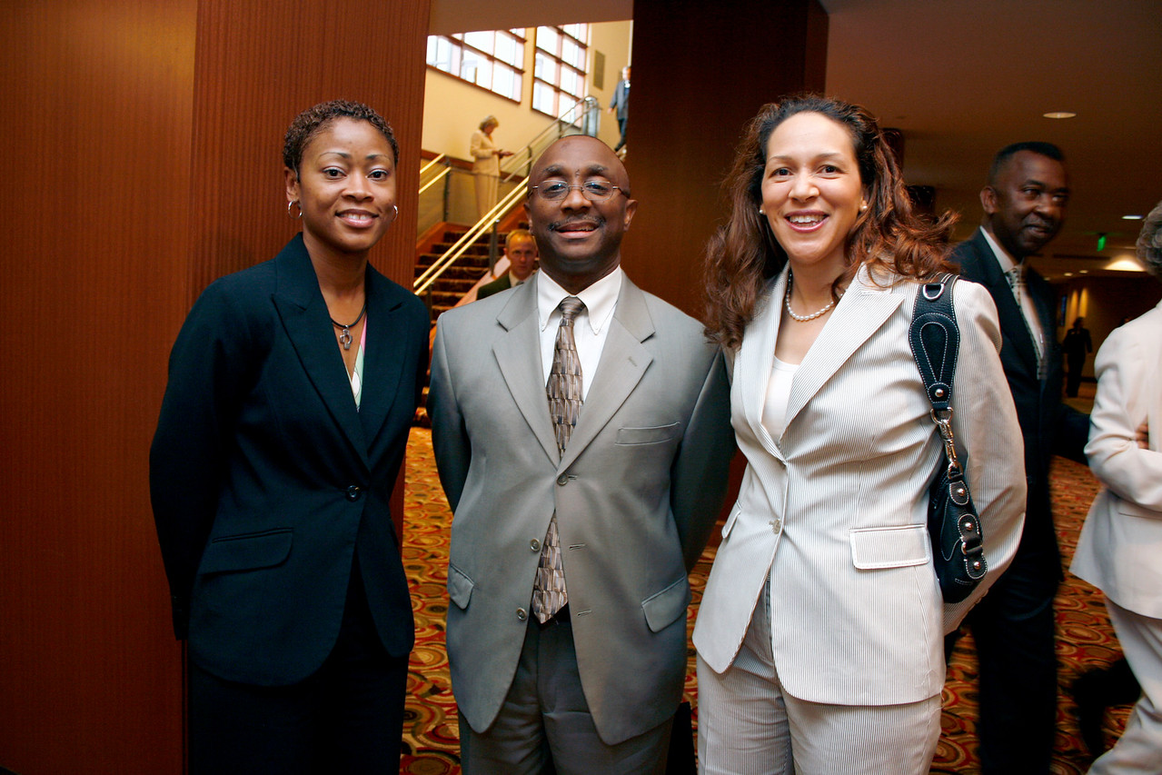 Conference attendee; Anthony Coleman, City of Dallas and Katrina Keyes, K Strategies and Conference Co-Chair