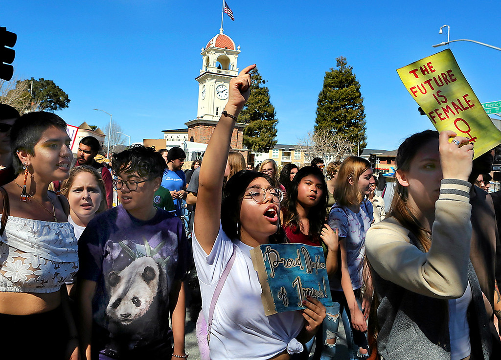. International Women\'s Day strikers bring their message down Pacific Avenue after a midday protest at the Santa Cruz Clock Tower. (Shmuel Thaler -- Santa Cruz Sentinel)