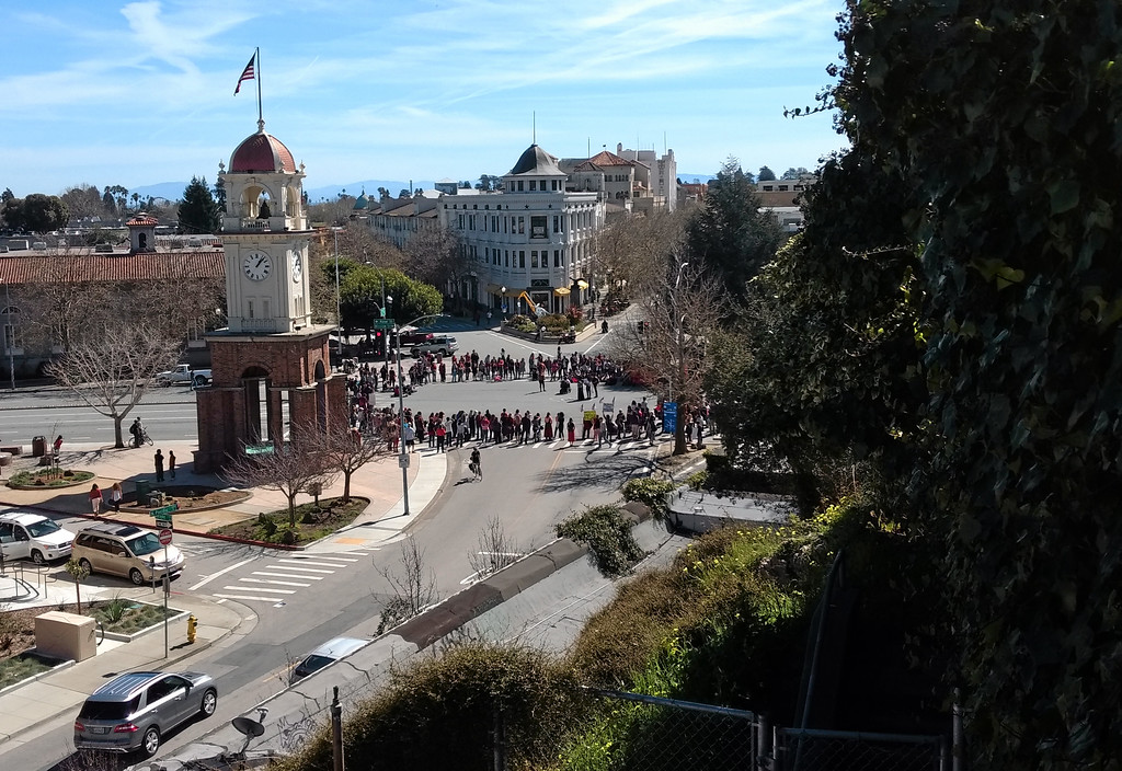 . Protesters circle up. (Ryan Masters -- Santa Cruz Sentinel)