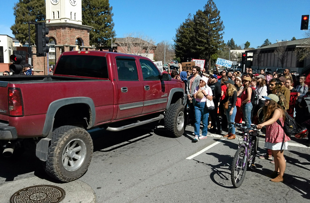. The driver of this Chevrolet truck threatened to plow through the protesters at Wednesday\'s International Women\'s Day Strike. His truck was pelted with dirt clods. He eventually left and was pulled over by Santa Cruz police. (Ryan Masters -- Santa Cruz Sentinel)