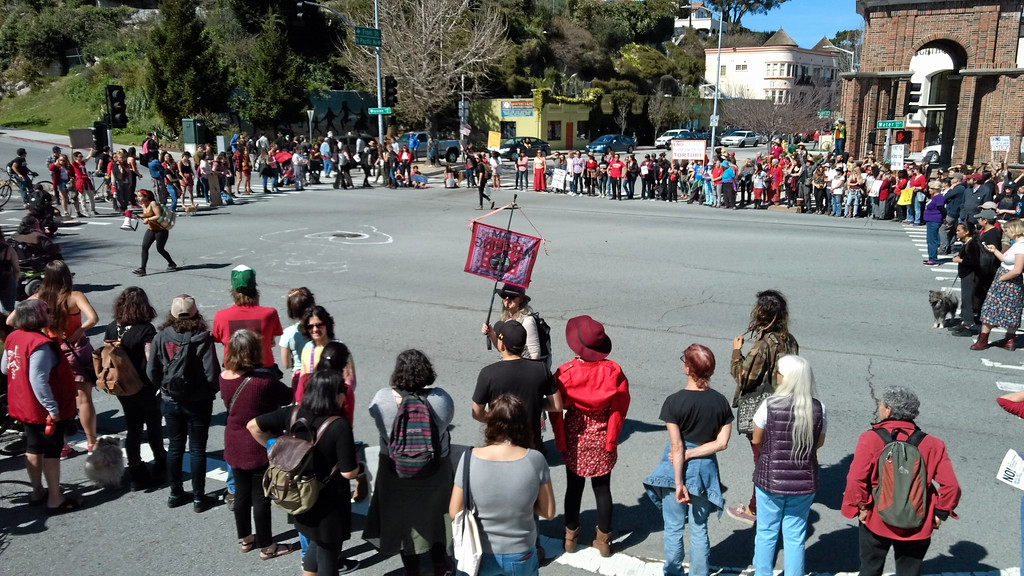 . Protest groups circle up at the intersection of Mission and Pacific streets, blocking traffic during the Santa Cruz International Women\'s Day Strike Wednesday. (Ryan Masters -- Santa Cruz Sentinel)