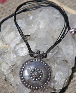 Black hair w/silver medallion, Morocco