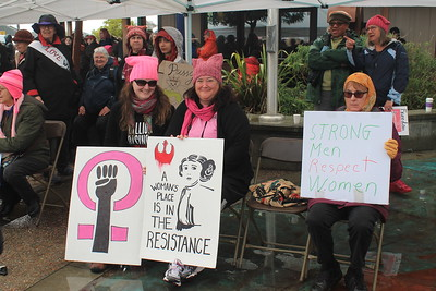 Megan Johnson, Rae Robinson and Barbara Schumacher attended the Women's March on Eureka with signs Saturday afternoon. (Natalya Estrada - The Times-Standard)