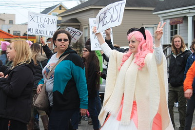 Many people wore pink and costumes to Saturday afternoon's march. The march was one of 600 coordinated marches planned to follow President Donald Trump's inauguration Friday. (Natalya Estrada - The Times-Standard)