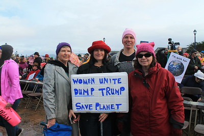 """Ivy Jeffers, Lisa Jeffers, Angela Rex and Julia Peterson attended Saturday's march with a """"dump Trump"""" sign. (Natalya Estrada - The Times-Standard)"""