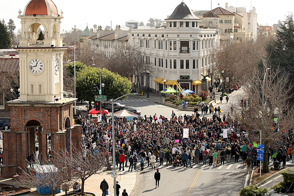 . Hundreds of protesters--many of them UC Santa Cruz and high school students-- clog the intersection of Pacific Avenue and Water Street in downtown Santa Cruz to rally against the inauguration of President Trump Friday.  (Dan Coyro -- Santa Cruz Sentinel)