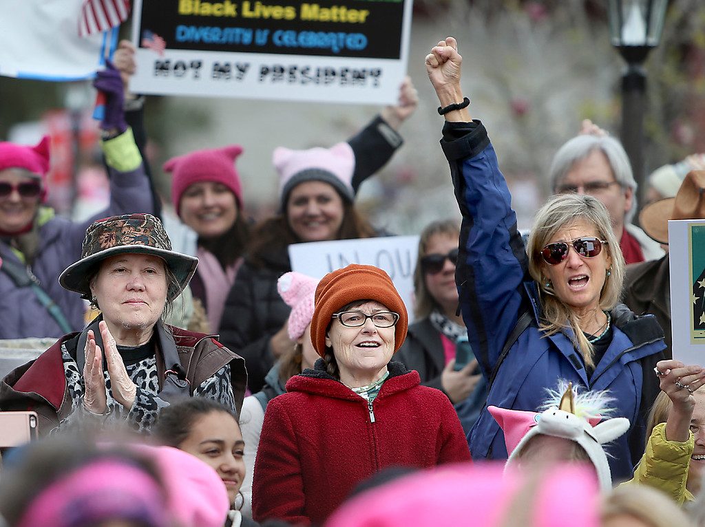 . Demonstrators cheer outside of Santa Cruz City Hall on Saturday during the Santa Cruz County Women\'s March in protest of president Donald Trump\'s inauguration. (Kevin Johnson -- Santa Cruz Sentinel)