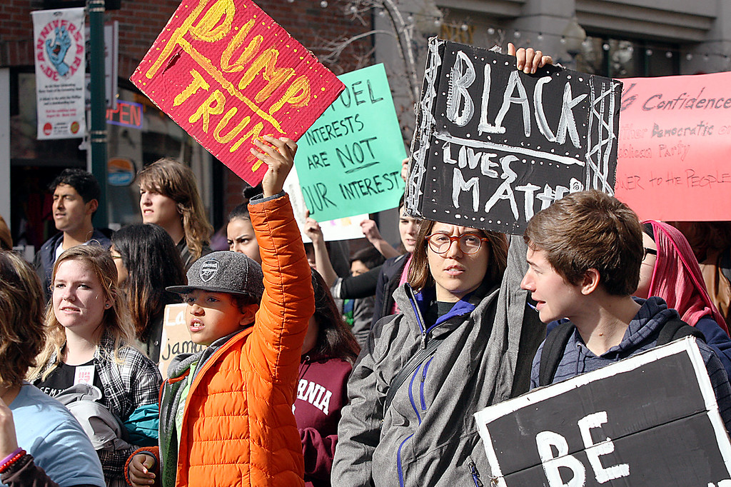 . Demonstrators leave the Town Clock to march down Pacific Avenue chanting \'our streets,\' as they protest the inauguration of President Trump on Friday.   (Dan Coyro -- Santa Cruz Sentinel)