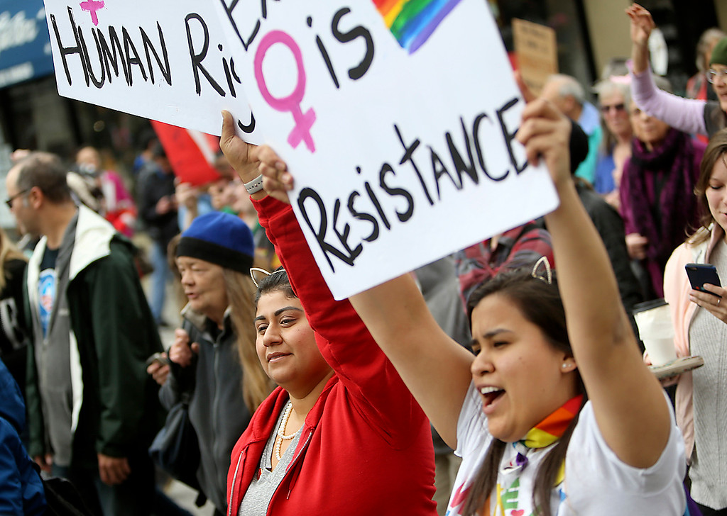 . protestors march in solidarity against President Donald Trump during the Santa Cruz County Women\'s March on Pacific Avenue on Saturday. (Kevin Johnson -- Santa Cruz Sentinel)