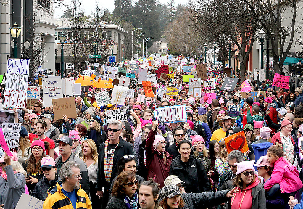 . Thousands march down Church Street and onto Pacific Avenue on Saturday afternoon as the Santa Cruz County Women\'s March overtook downtown Santa Cruz in a stand against President Donald Trump. (Kevin Johnson -- Santa Cruz Sentinel)