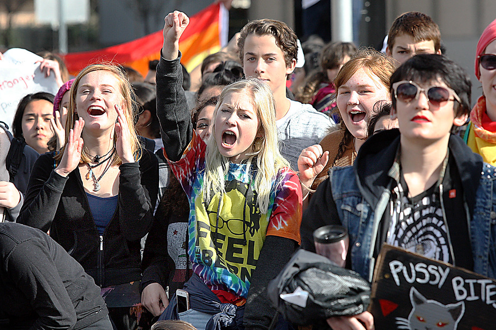 . Protesters--many of them UC Santa Cruz and high school students--rally Friday at the Town Clock against the inauguration of President Donald Trump.  (Dan Coyro -- Santa Cruz Sentinel)