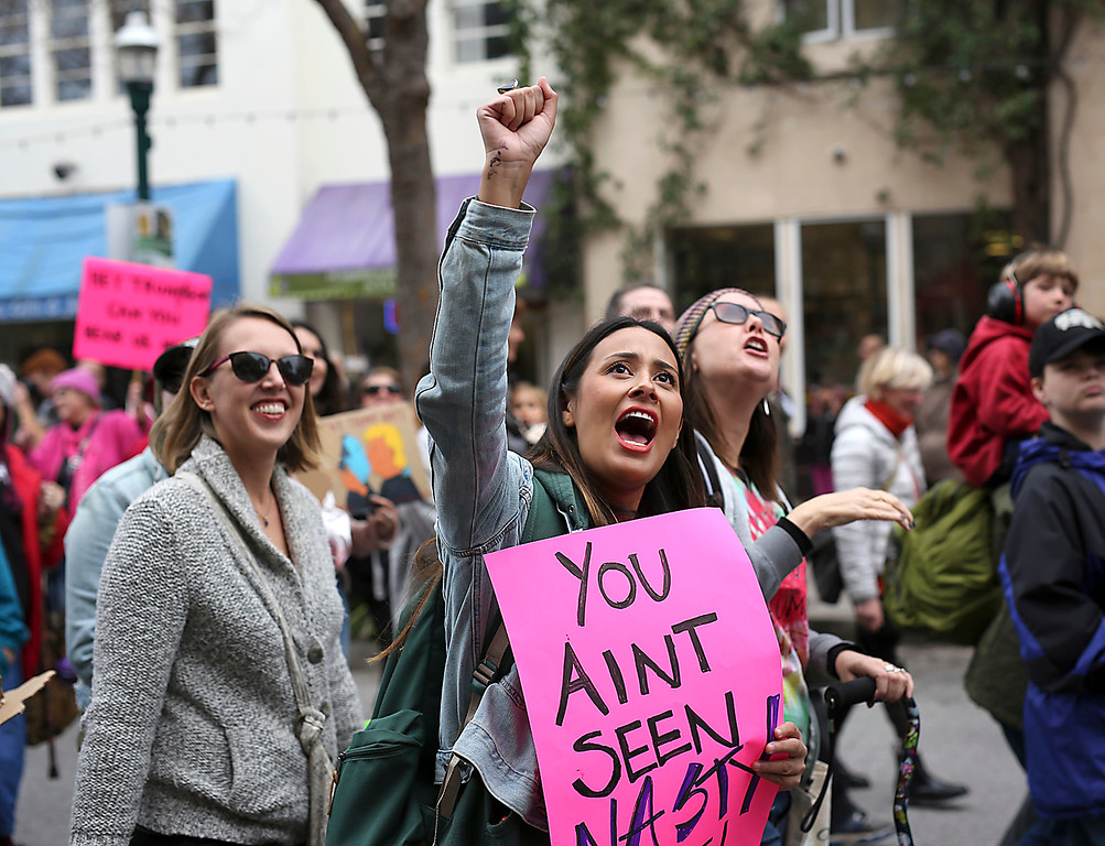. Protestors shout as they march along Pacific Avenue in downtown Santa Cruz on Saturday during the Santa Cruz County Women\'s March. (Kevin Johnson -- Santa Cruz Sentinel)