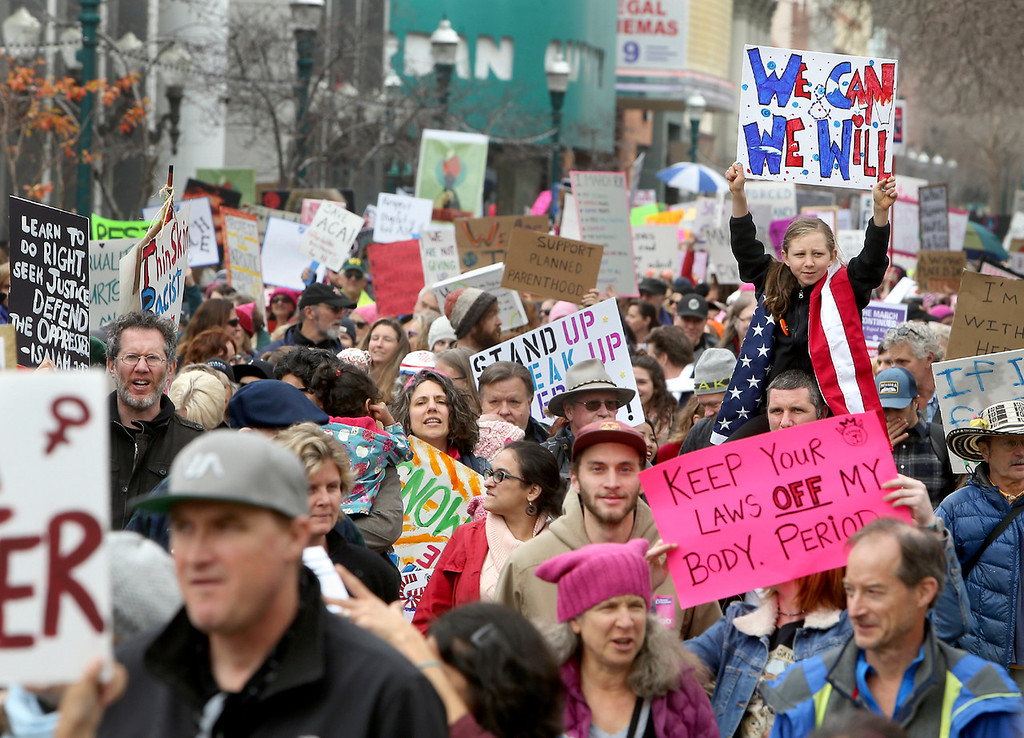 . Thousands pack Pacific Avenue on Saturday afternoon as they participate in the Santa Cruz County Women\'s March in protest of president Donald Trump. (Kevin Johnson -- Santa Cruz Sentinel)