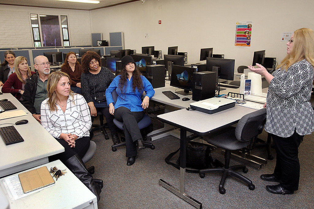 . Calais Ingel, at right,  meets with Cabrillo College Computer Application and Business Technology instructors to discuss which classes students need to take in the upcoming semester in order to find jobs.  (Dan Coyro -- Santa Cruz Sentinel)