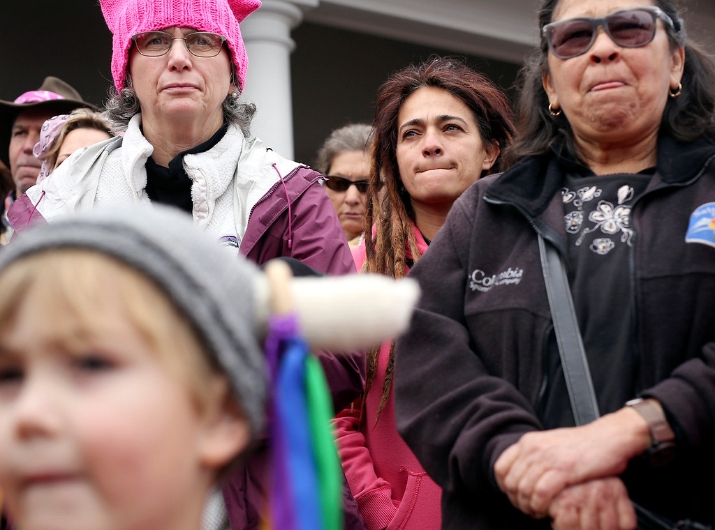 . Women stand together outside of Santa Cruz City Hall on Saturday before the start of the Santa Cruz County Women\'s March in protest of President Donald Trump. (Kevin Johnson -- Santa Cruz Sentinel)