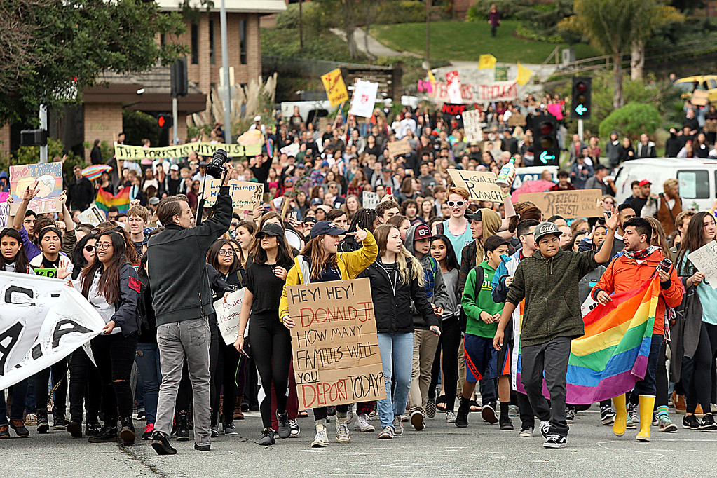 . High school and middle school students join up with UC Santa Cruz students marching down Water Street from Mission Hill to join other demonstrators at the Town Clock in protesting President Donald Turmp\'s inauguration Friday.  (Dan Coyro -- Santa Cruz Sentinel)