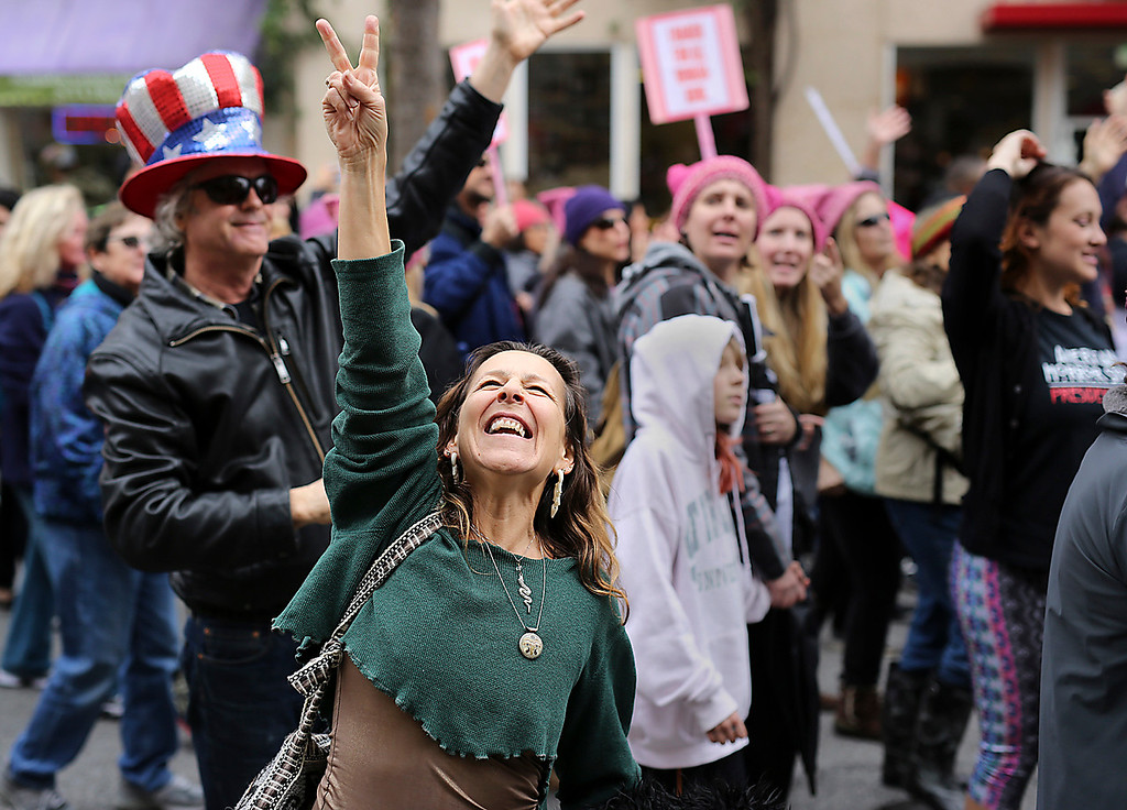 . Thousands took to Pacific Avenue in downtown Santa Cruz on Saturday to participate in the Santa Cruz County Women\'s March. (Kevin Johnson -- Santa Cruz Sentinel)