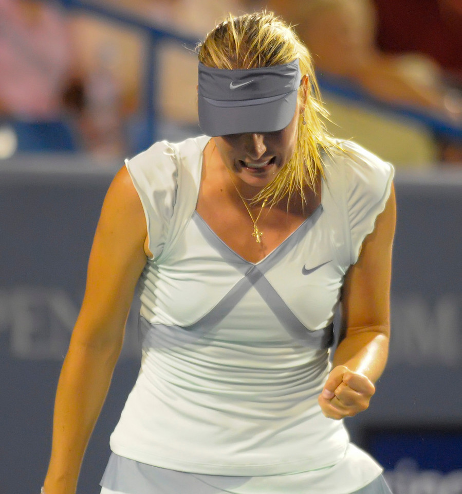 Maria Sharapova (RUS) celebrates after defeating Svetlana Kuznetsova (RUS).Western & Southern Financial Group Women's Open.(CincySportsZone/Scott Davis)