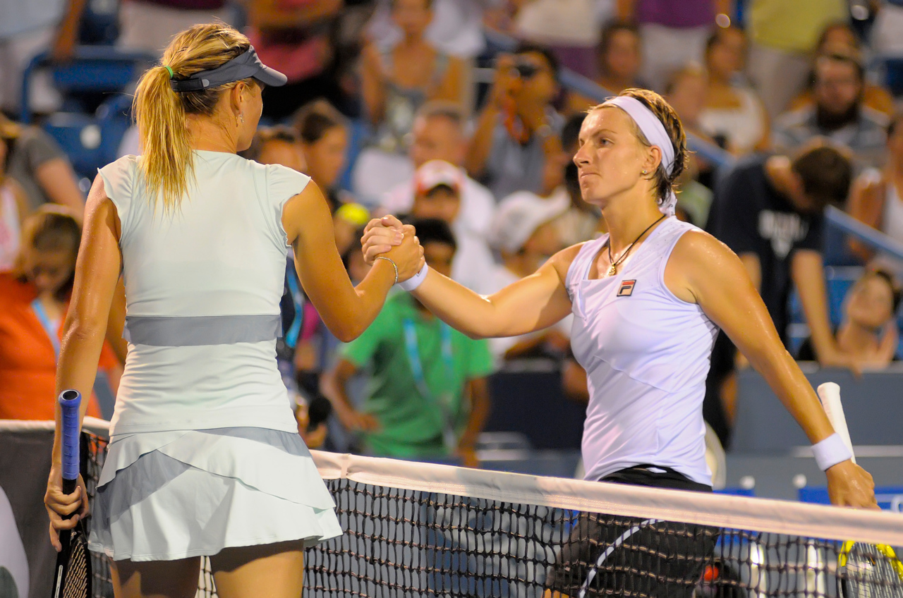 Sharapova (RUS) getting congratulations from Kuznetsova (RUS) after the match. Western & Southern Financial Group Women's Open.(CincySportsZone/Scott Davis)