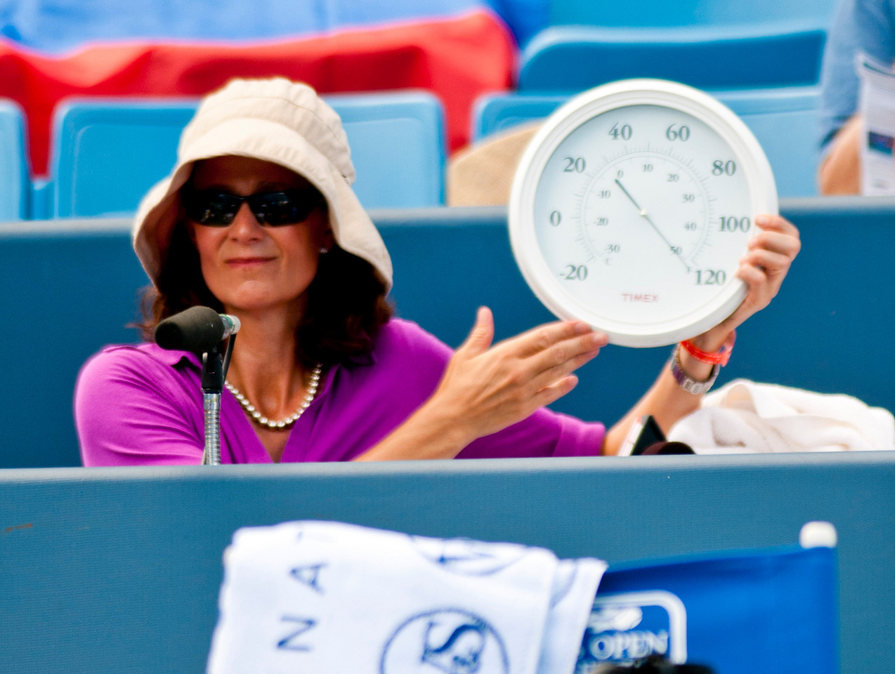 ESPN's Pam Shriver shows how hot it was today while Sharapova and Radwanska were playing there match. Western & Southern Financial Group Women's Open.(CincySportsZone/Scott Davis)