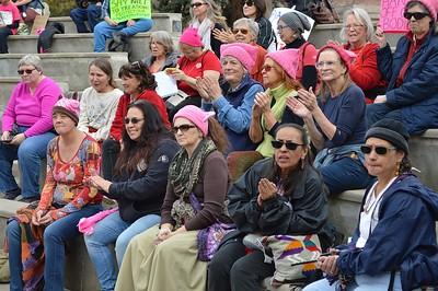 Group of women applauding a speaker at the 1 Billion Rising rally in Denver.