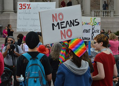 """Young woman with """"No Means No"""" sign at the 1 Billion Rising rally in Denver."""