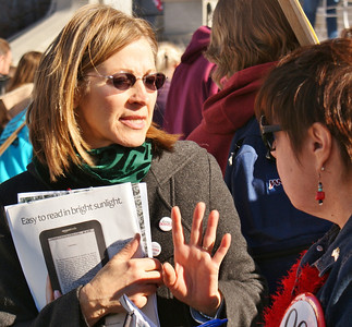 Woman disccusses petition with signer.
