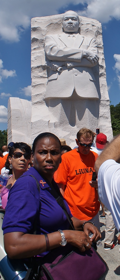 African-American woman with Martin Luther King statue in background.