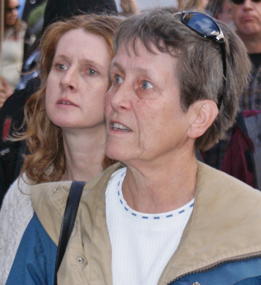 These two women at an occupy march in Denver, listen to a speaker.