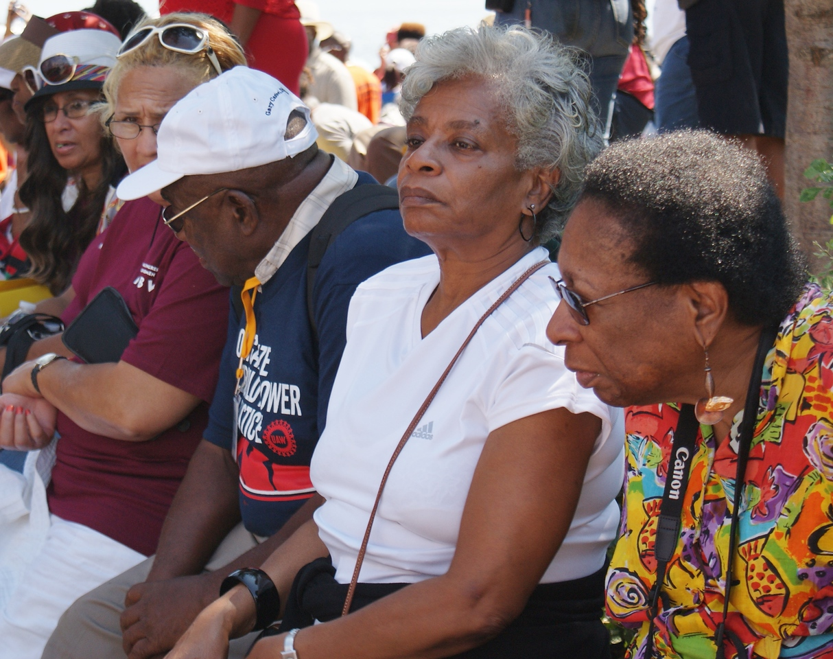 Senior African-American women sitting in a row.