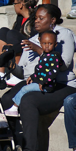 African-American woman with young child at MLK Day rally in Denver.